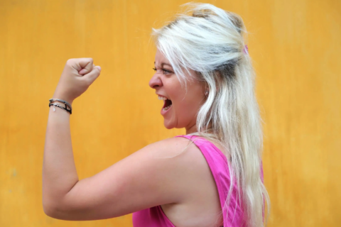 person flexing arm muscle